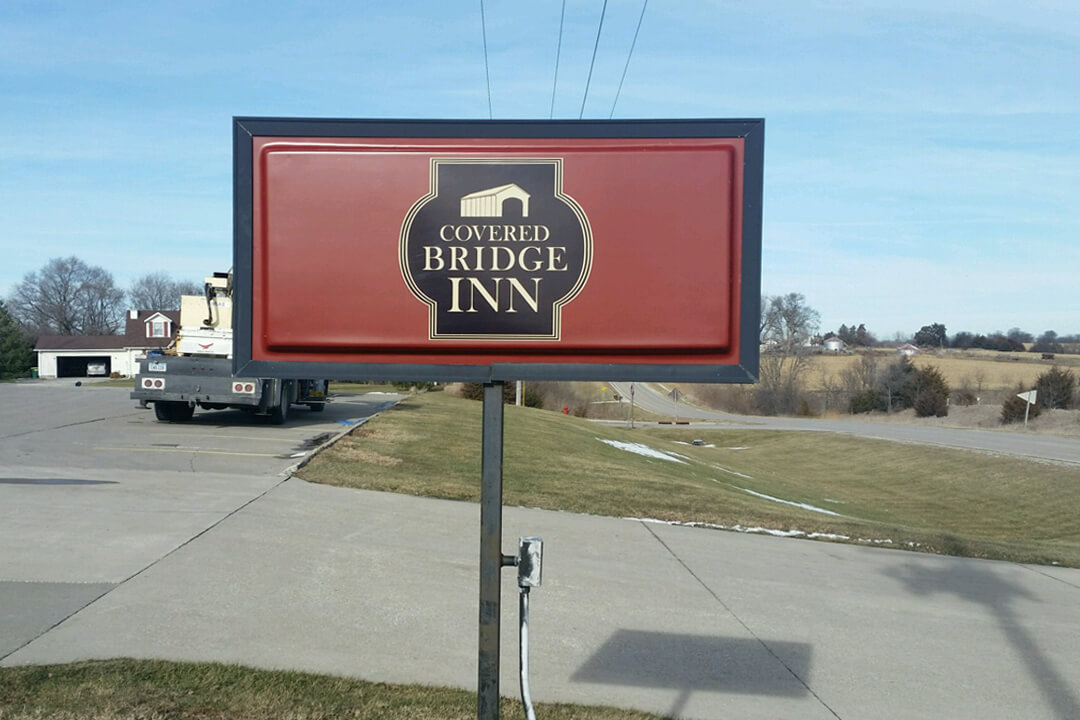 HOSPITALITY COVERED BRIDGE POST SIGN
